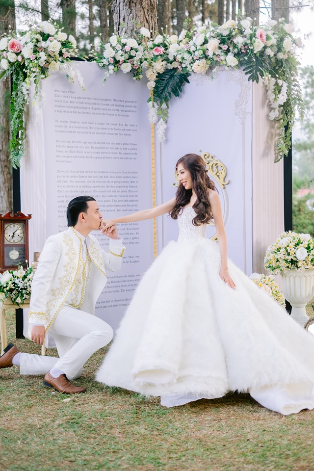 """Kor and Ken and their storybook. This book has some """"codes"""" that guests decoded while the couple had their post nuptial photos taken. Guests also enjoyed other fun games like vintage key hunting."""
