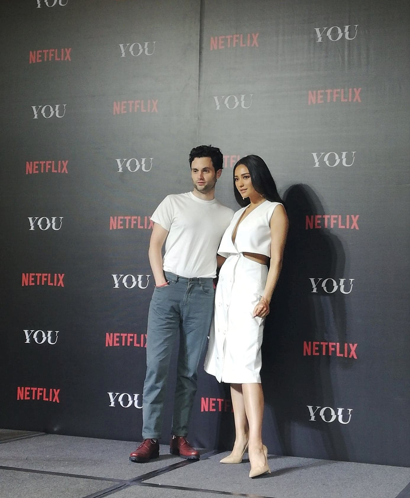 """Penn Badgley and Shay Mitchell of Netflix Original series, """"YOU"""" pose for photos after their exclusive sit-down panel, """"In Conversation with YOU"""" at The Peninsula Manila on January 14, 2019"""